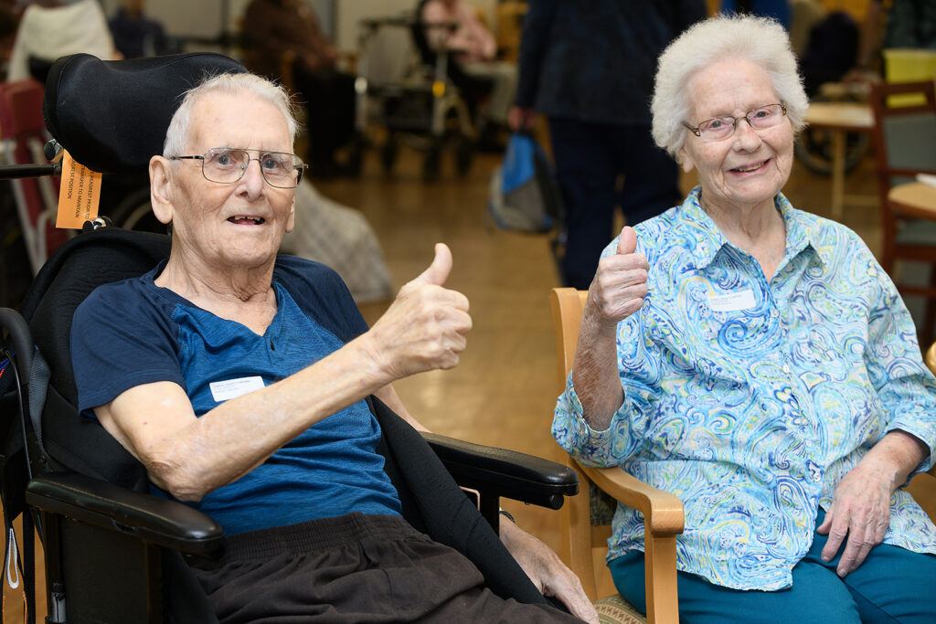 Everett and Thelma, residents at Veterans Memorial Lodge long term care home in Victoria BC, give thumbs up after receiving their second-dose COVID-19 vaccination.